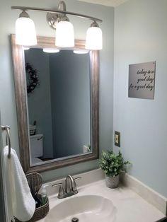 Farmhouse small half bath renovation. Fixer Upper bathroom in Sherwin Williams sea salt and dorian gray cabinets