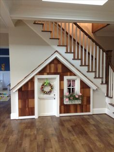 Under stairs playhouse. Our grand babies are loving it!