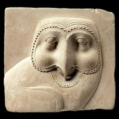 Relief plaque with face of an owl. Egypt, 400–30 B.C.