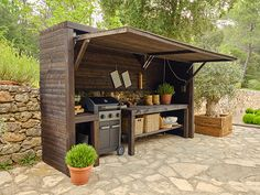 An outdoor kitchen can be an addition to your home and backyard that can completely change your style of living and entertaining. Rustic Outdoor Kitchens, Outdoor Kitchen Patio, Outdoor Kitchen Design, Outdoor Life, Outdoor Living, Outdoor Decor, Outdoor Grill Station, Outdoor Grill Area, Diy Bbq Area