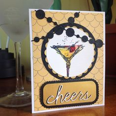 60 th birthday card for a friend who loves lemon drop martinis.  Art Impressions martini stamp.  Reverse Confetti circle garland die, PTI shaker and labels dies, SSS basic stitched shape die, Memory Box cheers script die, Lifestyle circle die, Spellbinders Scallop die.  Color burst and distress inks with water color brush.  Teresa Collins pattern paper, water color paper, Recollections black sparkle paper and clear Nuvo.