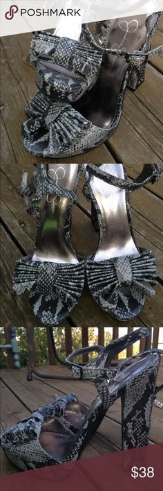 Jessica Simpson Snakeskin Chunky heeled slingbacks Fabulous conditions!  Black silver and white uppers with a fanned bow over the top of the toes. Adjustable straps with a high chunky heel. Platform Jessica Simpson Shoes Platforms
