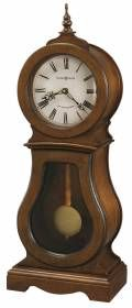 Howard miller chiming quartz mantel clock 635157 CLEO-Mantel clock finished in Chestnut on select hardwoods and veneers, this traditional wooden mantel clock features a turned finial and seeded glass in the lower door.