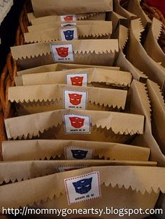PARTY BAGS: Simple stickers can transform plain paper bags into themed party bags