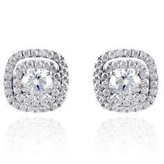 Jacket Collection � These striking 18K white earring jackets are comprised of 1.40ctw round white Diamonds. � ME1561