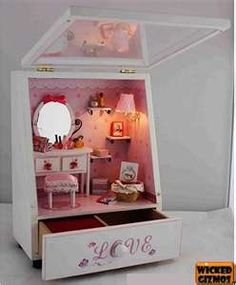 Pink Miniature room inside a jewelry box.