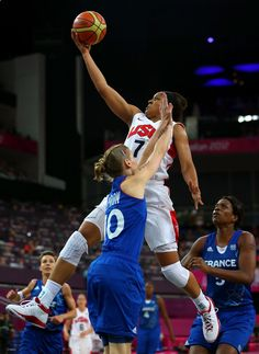 Maya Moore of the US women's basketball team goes up strong for a shot as the US women win the gold.