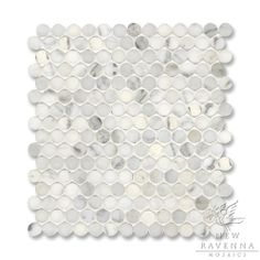 2cm pennyrounds pattern shown in Calacatta Radiance by Ravenna
