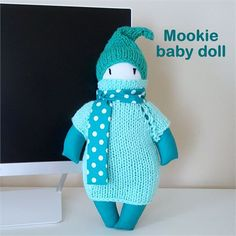 Adorable, hugable, soft and warm ! This doll is a keepsake, ready to be passed on to the next baby in the family !   Safe for babies and toddlers of any age, the doll does not have any small parts that might pose a danger. I love to create and make my own patterns of dolls, and all of them seems to have their own personality !    Doll features :   Color : Teal   Height : 12 1/2 inch without the pointy hat   Materials : 100% cotton fabric, hypoallergenic filling, soft imported yarn   Othe...