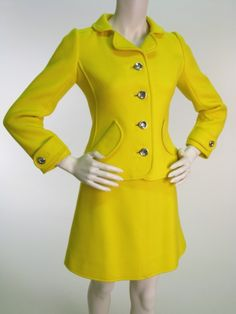 Andre Courreges suit 65-67.  I would absolutely wear this now.  To work.