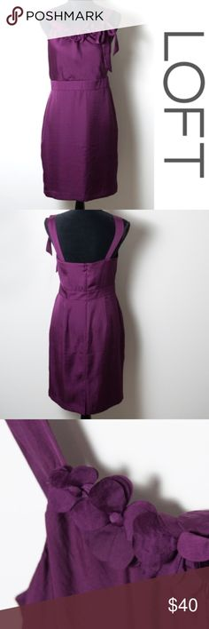 NWT Purple LOFT Dress Floral Appliqué Neckline 6 New with tags dress from LOFT. Purple with flower accents at neckline and bow. Falls right above the knee. Size 6  tags - girly, flirty, cocktail dresses, cute dresses, new dresses, flower, floral, girls night, date night, occasion, party, sexy, dressy, feminine LOFT Dresses Midi