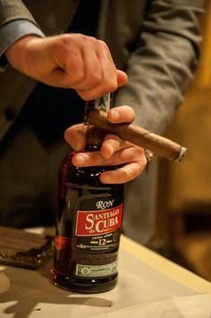 Extraordinary Cuban rum Santiago de Cuba Extra Aged 12 years, and exquisite Cuban cigar.