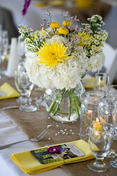 yellow and white centerpiece in simple clear vase with burlap- add our pink with the white and yellow.