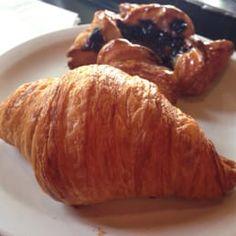 Photo of Café Besalu - Seattle, WA, United States. Croissant and blueberry Danish
