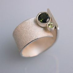 Andreas Schiffler | This ring is made of sterling silver. It has a 3mm periodot and a 6mm turmaline.