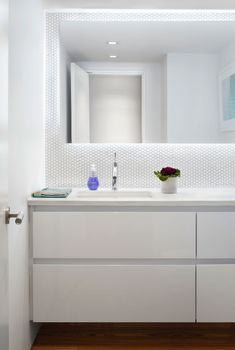 White bathroom Colourful and Light Filled Apartment in Manhattan by Axis Mundi Design