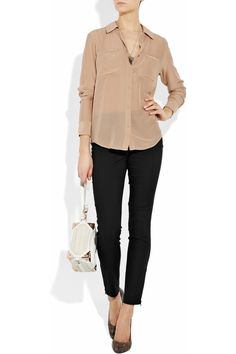 Trendy office blouse and skinny pants. Brought to you by Shoplet.com - everything for your business.