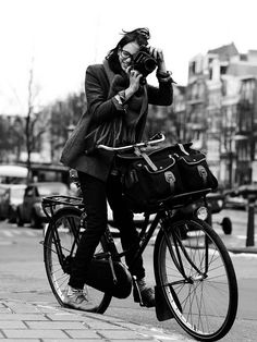 Bike check, woman in cool clothes check, camera check, specs check, bag check, black & white check... :o)