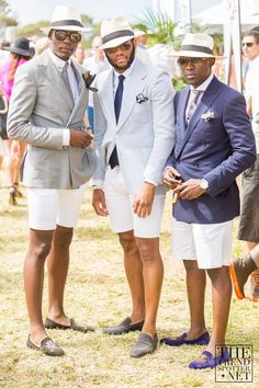 BEST IN SHOW: These gents always deliver the sartorial goods at Melbourne events. White shorts with double breasted jackets in pintstripe and seersucker. Paired with classic Italian loafers and panama hats. Winner winner chicken dinner.
