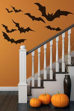 Vinyl bat decals: just as spooky as those fake cotton spiderwebs — and far easier to whisk cleanly away post-Halloween. #etsyfinds