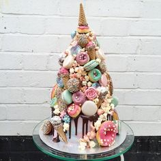 All the major dessert food groups rolled into one showstopping croquembouche. Perfect for weddings and milestone celebrations delivered across London and beyond