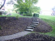 Boulder steps and tamped limestone path. Designed and installed by eichenlaub.