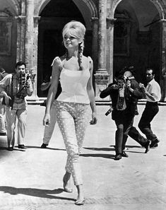 Brigette Bardot. Seemingly oblivious to the fact that everyone is gawking at her and snapping pictures.