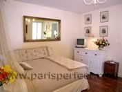 Studio apartment has a queen-sized bed and plenty of storage -  use of mirror, dresser, prints