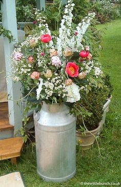 A classic Wilde Bunch rustic milk churn wedding design at Maunsel House, Somerset. Our barn HQ is on a dairy farm just outside Bristol so our churns are 100% the genuine article....no naff half sized replicas in our designs!!