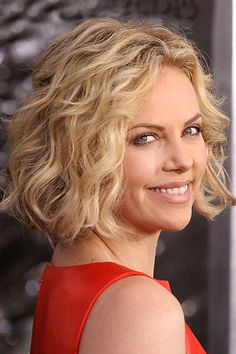 Want to make curly hair more manageable? Try a chin-skimming curly bob hairstyle like Charlize's.