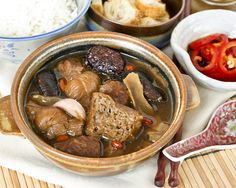 Bak Kut Teh (Pork Ribs Tea) is a Chinese herbal soup with dong gui known for its warming properties. This comforting dish is perfect for the colder months. | RotiNRice.com