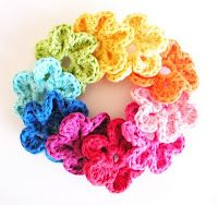 Another crochet flower pattern for hair clips - would be cute with button in middle. Or make a few more & turn into a wreathe