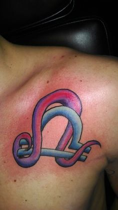 Leo and Libra tattoo.... can also be a cute couple /marriage tattoo if it's a coincidence
