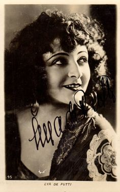 PUTTI LYA DE: (1897-1931) Hungarian Film Actress of the silent era, noted for her portrayal of vamp characters. Vintage signed postcard photograph of Putti in a head and shoulders pose. Signed ('Lya De Putti') in bold black fountain pen ink across a light area of the image.