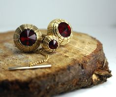 Amazing brilliant faceted red and textured gold cufflink and tie tack set. Pristine condition. Heavy metal and gorgeous gold tone  Amazing brilliant faceted red and textured gold cufflink and tie tack set. Pristine condition. Heavy metal and gorgeous gold tone ModernRenaissanceMan, $38.00
