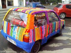 The intro text here is minorly offensive but the four yarnbombed car covers are worth taking a look at