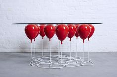 a table that looks like it's being held up by balloons
