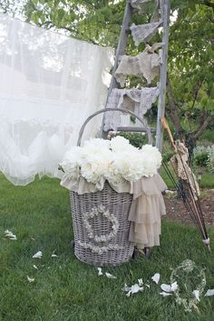 Where to start!  Love the basket, ladder, lace, flowers & clothesline.  :)