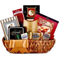 """Classic Gourmet Gift Basket. Gourmet treats is the perfect gift for satisfying any recipient! A lovely basket holds nine tantalizing selections, including Seasoned Almonds, Ghirardelli Chocolates, Cheese Biscuits, Almond Roca, and more. Filled with foods that everyone enjoys and always smart choice for sending your best. Weighs 4lbs / Measures 11"""" x 8"""" x 4""""."""