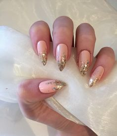 Peach stiletto false nails with gold glitter ombre by nailartbygeorgia on Etsy https://www.etsy.com/listing/290018993/peach-stiletto-false-nails-with-gold