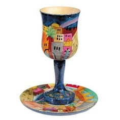 This stunning Vista of Jerusalem Design Kiddush cup by  Emanuel is the perfect one to bring color and warmth to your Shabbat or Yom Tov table. The cup is made in a beautiful goblet shape with a stem. The set features the a beautiful view of Jerusalem with a nights sky.