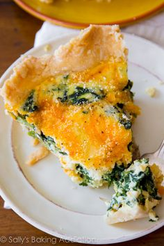 This super cheesy spinach quiche is baked in my favorite homemade pie crust. Impress all your brunch guests with this recipe! via @Sally [Sally's Baking Addiction]