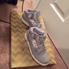 Grey with white Jordan's Used but still in great shape. Jordan Shoes Athletic Shoes