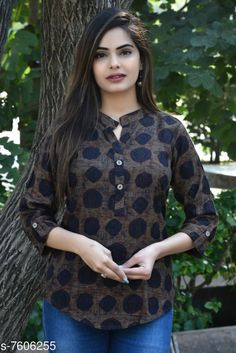 Tops & Tunics Women's Printed Brown Rayon Top Fabric: Rayon Sleeve Length: Three-Quarter Sleeves Pattern: Printed Multipack: 1 Sizes: XL (Bust Size: 17 in Length Size: 28 in)  L (Bust Size: 16 in Length Size: 28 in)  M (Bust Size: 15 in Length Size: 28 in)  XXL (Bust Size: 18 in Length Size: 28 in) Country of Origin: India Sizes Available: S, M, L, XL, XXL, XXXL   Catalog Rating: ★4 (502)  Catalog Name: Women's Rayon Tops & Tunics CatalogID_1231634 C79-SC1020 Code: 933-7606255-9921