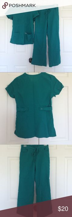 Grey's Anatomy 2 Piece Scrub Set - Jade Like New Condition, Greys's Anatomy 2 piece scrub set, jade (teal green) in color. Top size XS classic mock wrap with front pockets. Bottoms size XS petite, 28in inseam, 5 pocket drawstring flare leg. Grey's Anatomy Other