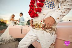 Great Elvis shot. This guy hangs out at the Las Vegas sign a lot. Too bad he doesn't wear this belt all the time.