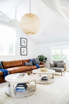 """The living room is where the mid-century coastal vibe really takes on a life of its own. This relaxed space has a perfect mix natural materials and textures to liven up the neutral palette. """"We..."""