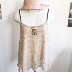 New Listing! Creme Trapeze Tank w/ Leather Straps Such a pretty and feminine tank, love the knotty knit material and faux leather, double straps. Trapeze style fit, very float. It is lined and in great condition. Size Medium, fits TTS, can also work on a Small though. By Deletta, from Anthropologie. Anthropologie Tops Tank Tops