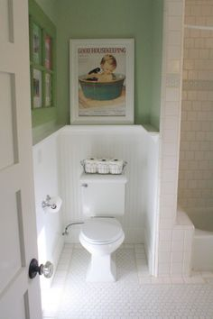 This bathroom is so pretty! I love the vintage style. Note the framed artwork above the commode. They used trim to build the frame - I have several pieces of artwork that need custom frames (too expensive). This is a perfect solution! Downstairs Bathroom, Small Bathroom, Bathroom Modern, Design Bathroom, Bathroom Interior, Bathroom Artwork, Framed Artwork, Penny Tile Floors, Favorite Paint Colors