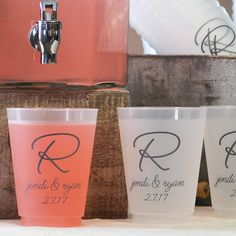 Shatterproof, reusable plastic cups custom printed with a wedding design, monogram or single initial along with the bride and groom's name and wedding date will add interest to your wedding reception bar or self-serve beverage station. These great conversation starters can be taken home for guests as wedding souvenirs to use again and again as they are dishwasher safe. These cups can be ordered at http://myweddingreceptionideas.com/16_ounce_personalized_frosted_plastic_cups.asp.